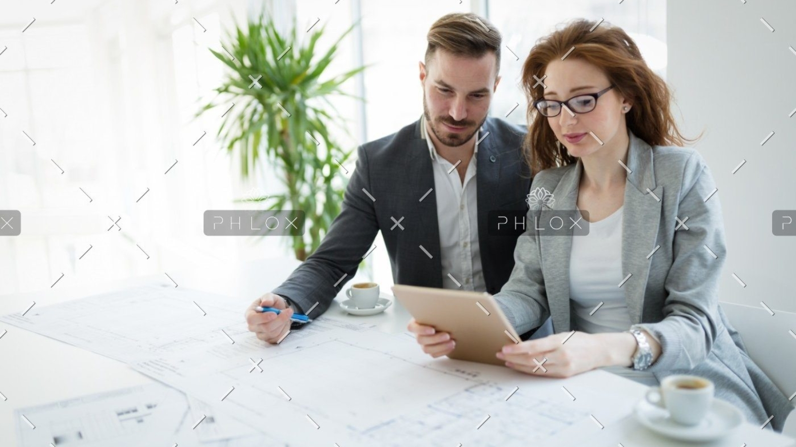 demo-attachment-818-portrait-of-young-architect-woman-on-meeting-KFZCE3A